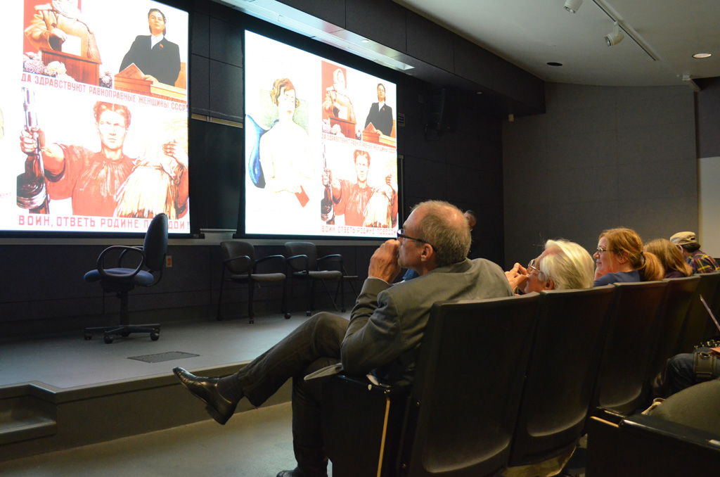 Robert English shares Soviet-era Russian posters depicting conservative representations of female sexuality as part of his presentation at the symposium. (USC Photo/Erica Christianson)