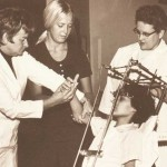 Helen Hislop, far right, and colleagues begin motion exercises with a polio patient following a spinal fusion. (Photo/courtesy of Rancho Los Amigos National Rehabilitation Medical Center)