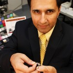 Mark Humayun, who is holding the Argus II artificial retina implant, plans to emphasize clinical, research and educational missions as director of the USC Eye Institute. (USC Photo/Jon Nalick)