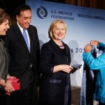 Hillary Clinton receives the award and a handwoven rebozo shawl from USMF President and CEO Martha Smith (left), former Cabinet member Henry Cisneros and Maria Echaveste, USMF trustee and MALI co-chair. (USC Photo/Steve Cohn)
