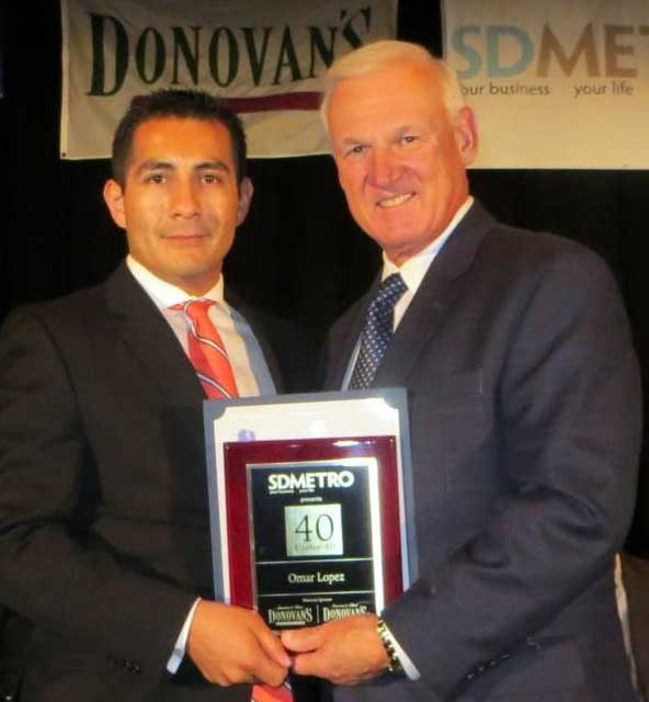San Diego County Supervisor Ron Roberts, right, presents Omar Lopez with one of SD Metro magazine's 40 Under 40 Awards. (Photo/Tory Cox)