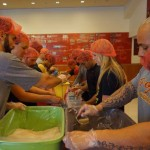 Trojans pack meals bound for the Philippines. (Photo/courtesy of USC Athletitcs)