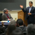 Professor Roberto Suro at desk and Rep. Xavier Becerra at a town hall discussion in Lewis Hall (USC Photo/Tom Queally)