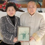 Victoria and Robert Wang with a photo of his parents in 2011