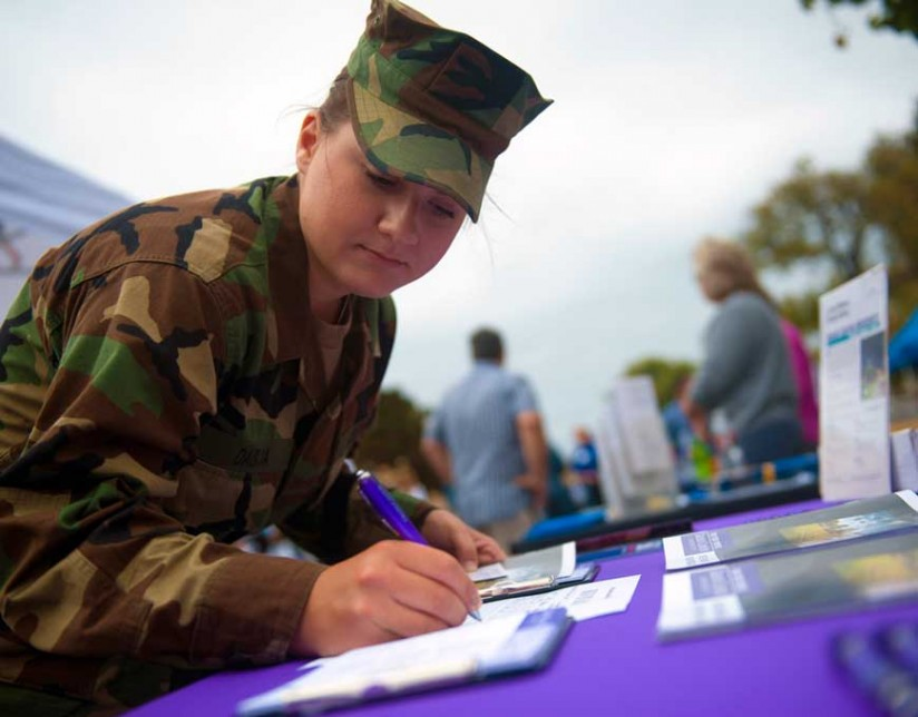 A woman in the U.S. Navy registers for information at an education fair in California. (Photo/Dominique Pineiro)