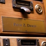 A brass plaque identifies the drawer for USC alumna Patsy Dewey in Doheny Memorial Library.
