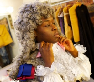 Stephens, a third-year MFA Acting student, adds a wig to her costume for King Louis XIV, one of three roles she plays in Tartuffe. (USC Photo/Dietmar Quistorf)