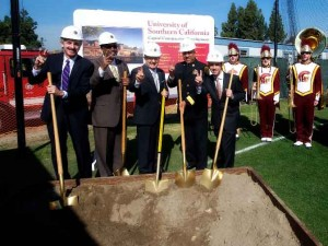 Los Angeles City Attorney Mike Feuer, left, Councilmember Curren Price, USC President C. L. Max Nikias, Los Angeles Interim Fire Chief James Featherstone and Councilmember Mitchell Englander break ground at the new USC Village fire station. (USC Photo/Dietmar Quistorf)