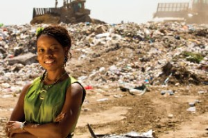 "Surveying the mountains of garbage surrounding her, USC Dornsife alumna Julia McGinnis said, ""I see energy. I see money."" (USC Photo/John Livzey)"