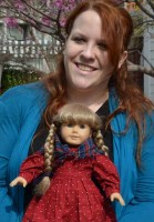 Senior Lucy Tew, holding her American Girl doll, landed an internship that led to a job and helped her senior capstone project. (USC Photo/Erica Christianson)