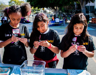young scientists learn buoyancy
