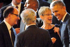 USC President C. L. Max Nikias and Elizabeth Garrett, provost and senior vice president for academic affairs, congratulate President Barack Obama. (Photo/Getty Images)