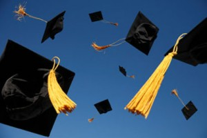 graduation caps fly