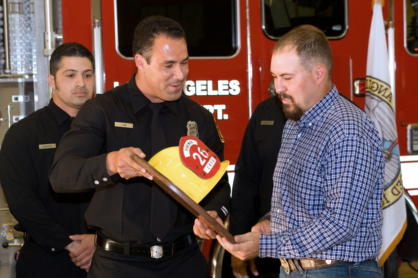 EML student and firefighter Jeffrey Lore, left, presents U.S. Army veteran Richard Carson with a plaque. (Photo/David Giannamore)