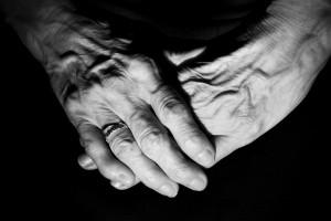 elders hold hands