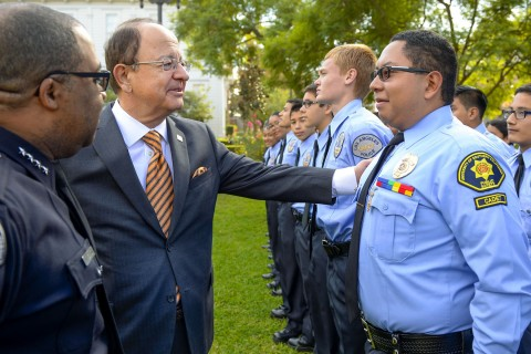 USC President C. L. Max Nikias talks with LAPD Cadet and USC freshman Ryan Lopez after announcing the university's annual grant to support the LAPD Cadet Leadership Program. (USC Photo/Gus Ruelas)