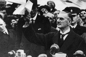 "Neville Chamberlain making his ""peace in our time"" speech after meeting Hitler in 1938."