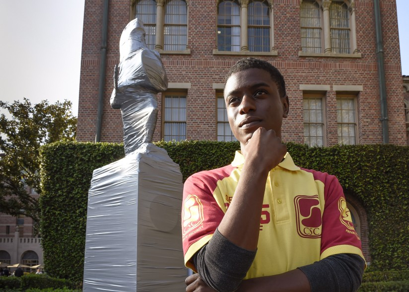 Tommy Trojan is wrapped, duck taped and guarded leading up to homecoming week, Friday, November 14, 2014,