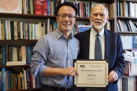 Weijie Wang, left, with Professor Terry Cooper