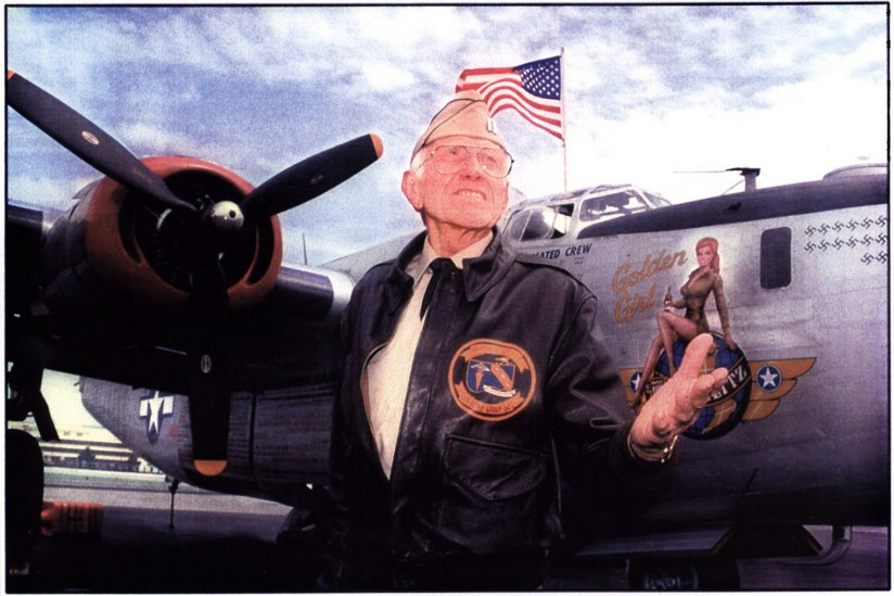 U.S. Army Air Corps bombadier Louis Zamperini next to a B24 bomber.