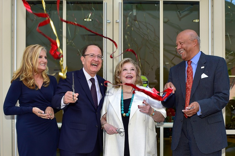 (left to right) NBC correspondent Alex Witt, USC President C.L. Max Nikias, philanthropist  and USC Trustee Wallis Annenberg and Dr. Ernest J. Wilson III, dean of the USC Annenberg School for Communication & Journalism as they cut the ceremonial ribbon during the Wallis Annenberg Hall Building Opening Celebration, Wednesday, October 1, 2014, in Los Angeles, California. (USC Photo/ Gus Ruelas)