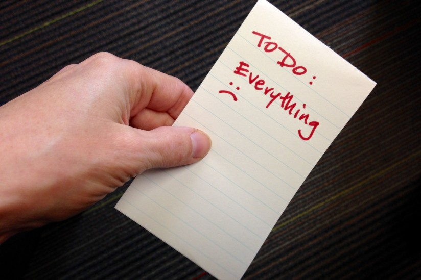 Hand with Post-It note