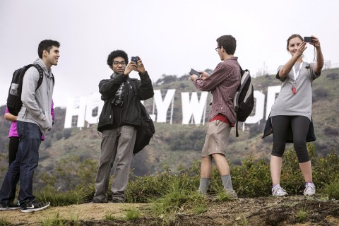 Students with Hollywood sign