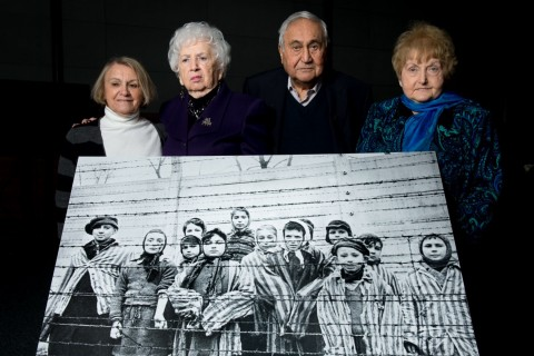 Survivors pose with iconic photograph