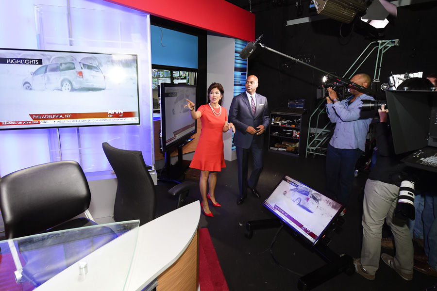 Julie Chen gives ET personality Kevin Frazier a tour of the media center