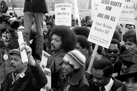 Jesse Jackson surrounded by marchers, racial equality,