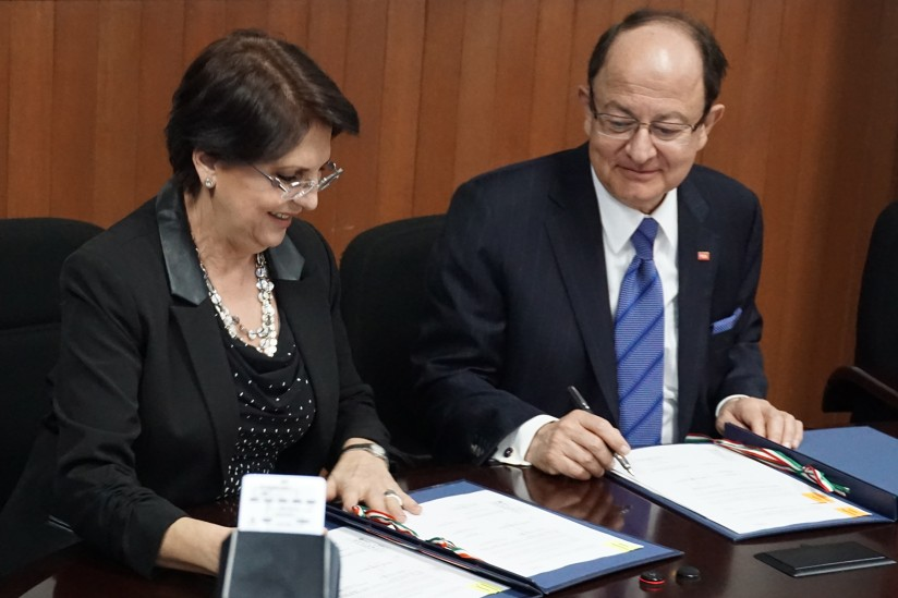 Maria Dolores Sanchez Soler and C. L. Max Nikias