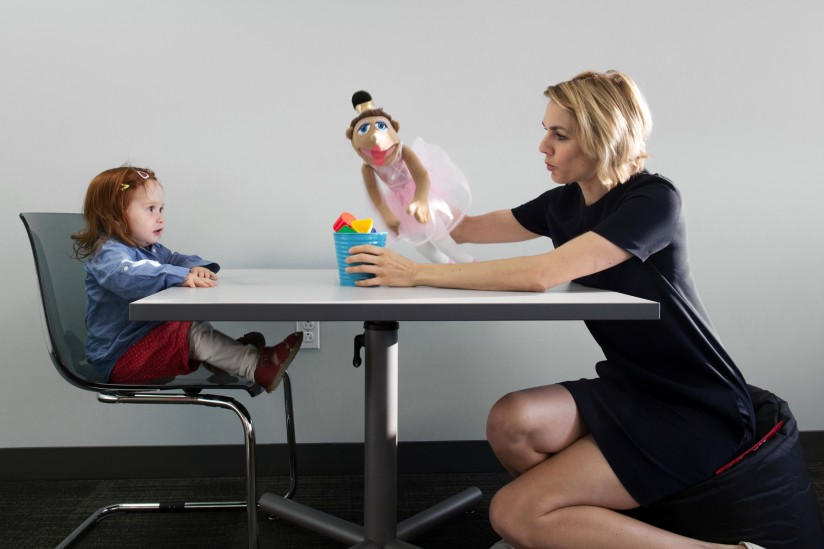 Henrike Moll, director of USC's Minds in Development Lab, plays with a child.