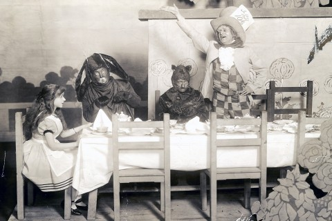 Tea party scene with Alice, Mad Hatter, Dormouse and March Hare, Alice in Wonderland.