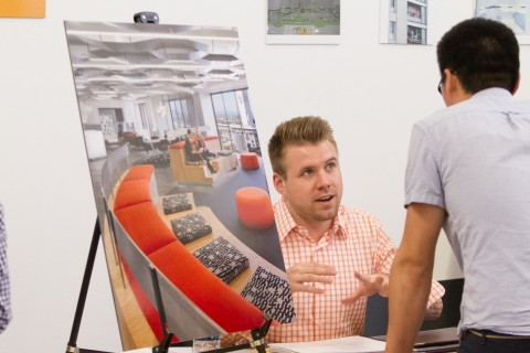A representative of an architectural firm talks to a student at USC Architecture's Firm Fair. (Photo/April Rocha)