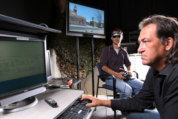 Skip Rizzo demonstrates the Bravemind virtual reality system.(Photo/Branimir Kvartuc)