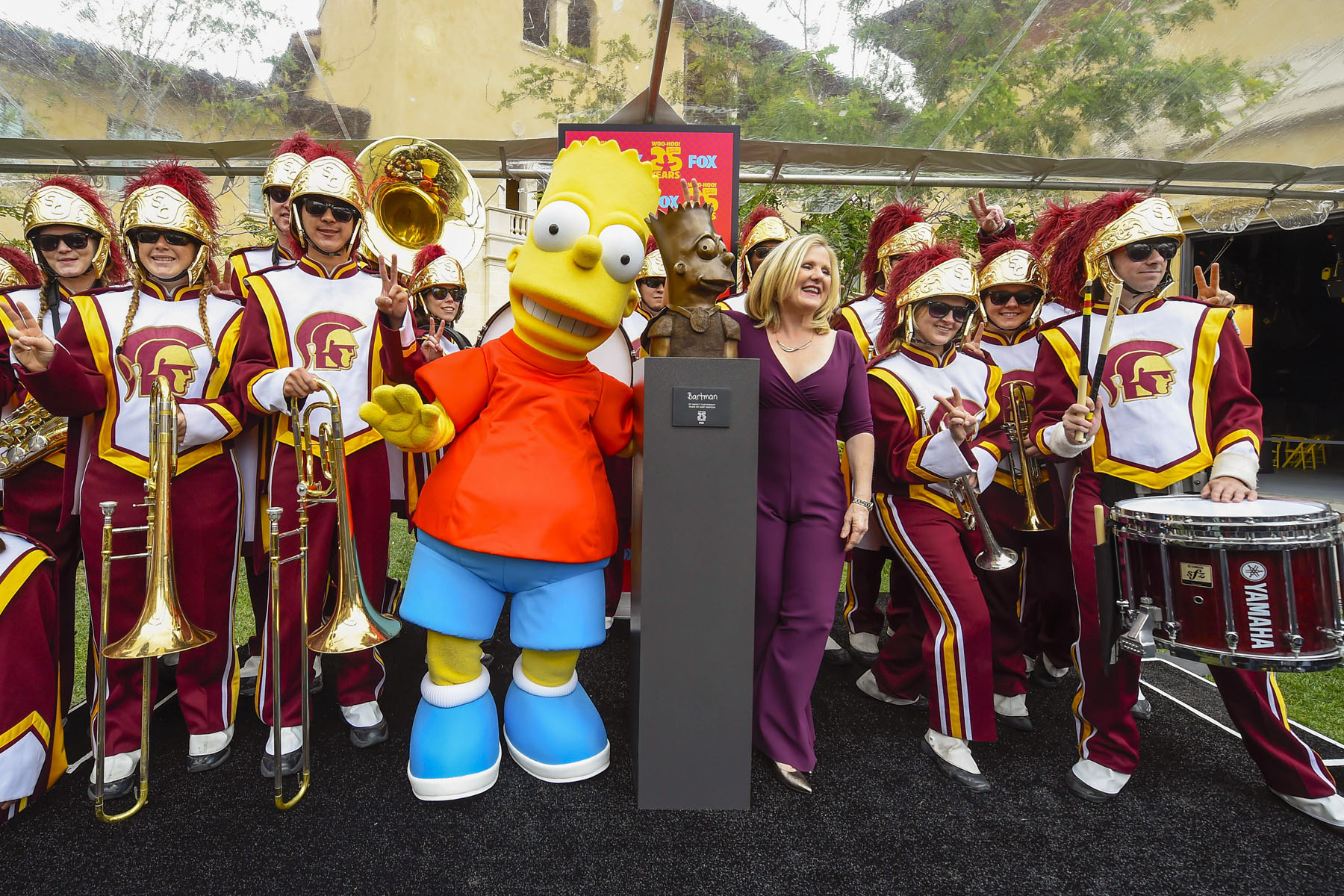 Cartwright celebrates  the unveiling of the sculpture with help from the Trojan Marching Band. (USC Photo/Gus Ruelas)