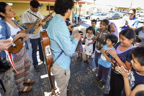 Children do a singalong with the band Quetzal during a songwriting workshop. (USC Photo/Gus Ruelas)