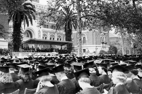 A familiar sight of students gathering in front of the Doheny Library on commencement day from 1954. (Photo/USC Digital Collections)