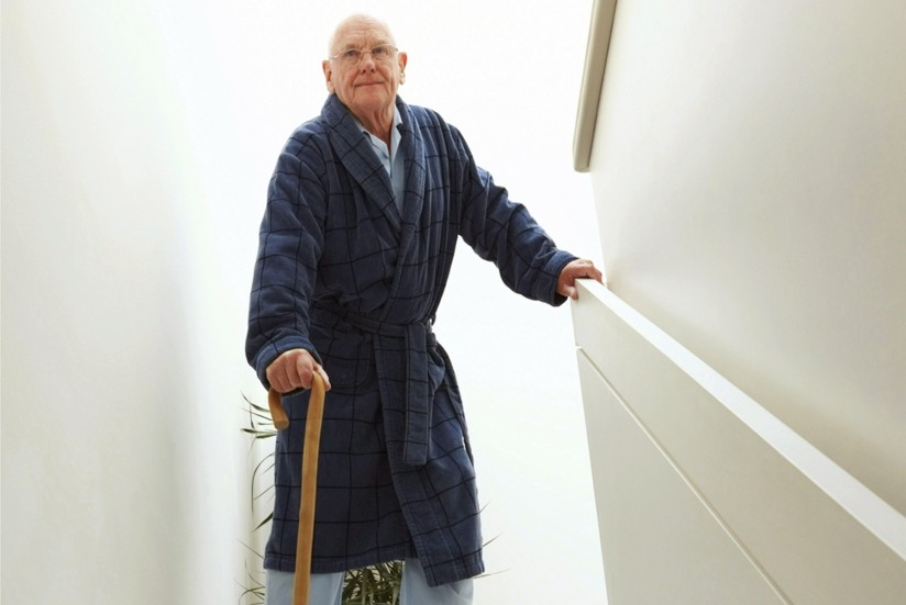 Old man with cane, on top of stairs