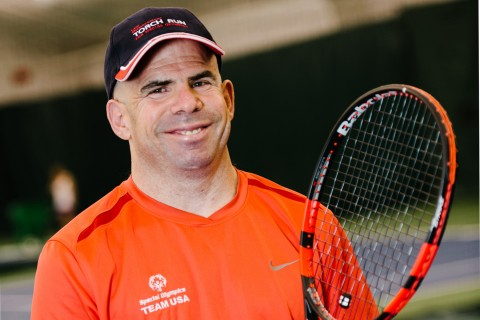 Jonathan Fried with tennis racket