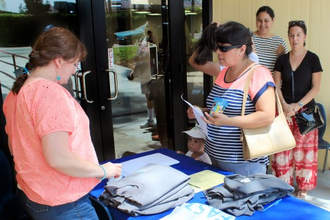 Parent Maria Jimenez picks up her daughter's new school uniform at USC East College Prep.(USC Photo/Merrill Balassone)
