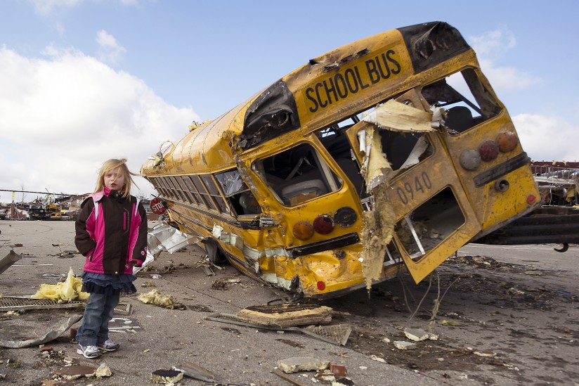 Madeline Evans of Henryville, Ind., walks the parking lot of her elementary school. The school and much of her town was devastated by a large tornado less the day before.