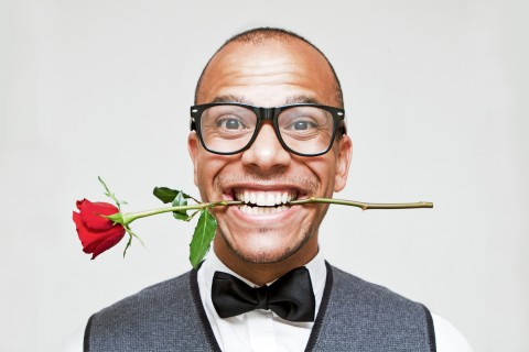 man with rose in teeth