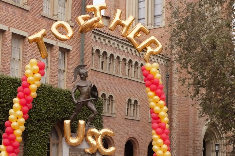 A cardinal and gold balloon arch designates the kickoff of the Division of Student Affairs' awareness campaign promoting caring and inclusivity at the university. (USC Photo/Gus Ruelas)