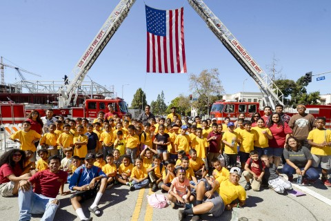 USC Community Outreach Kindergarden 2 College students pose for a picture during the dedication ceremony for Los Angeles Fire Department Station No.15, Saturday, October 10, 2015. (USC Photo/Gus Ruelas)