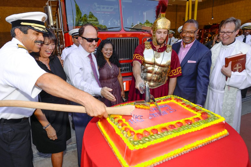USC President C. L. Max Nikias, LAFD Fire Chief Ralph Terrazas and California State Assemblyman Reginald Byron Jones-Sawyer, second from right, celebrate the grand opening of the new USC Firestation. (USC Photo/ Gus/Ruelas)
