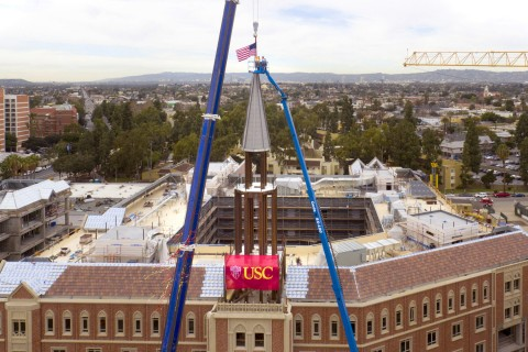 USC Village Cranes lift into position the spire