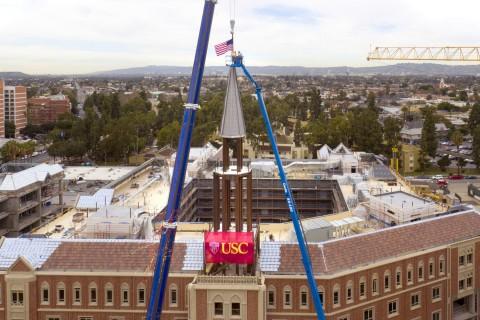 USC Village Cranes lift into position the spire