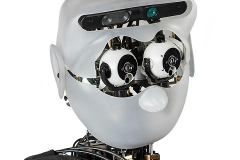 The Sarcos humanoid robot has helped USC researchers test an artificial spinal cord model. Photo by Luke Fisher