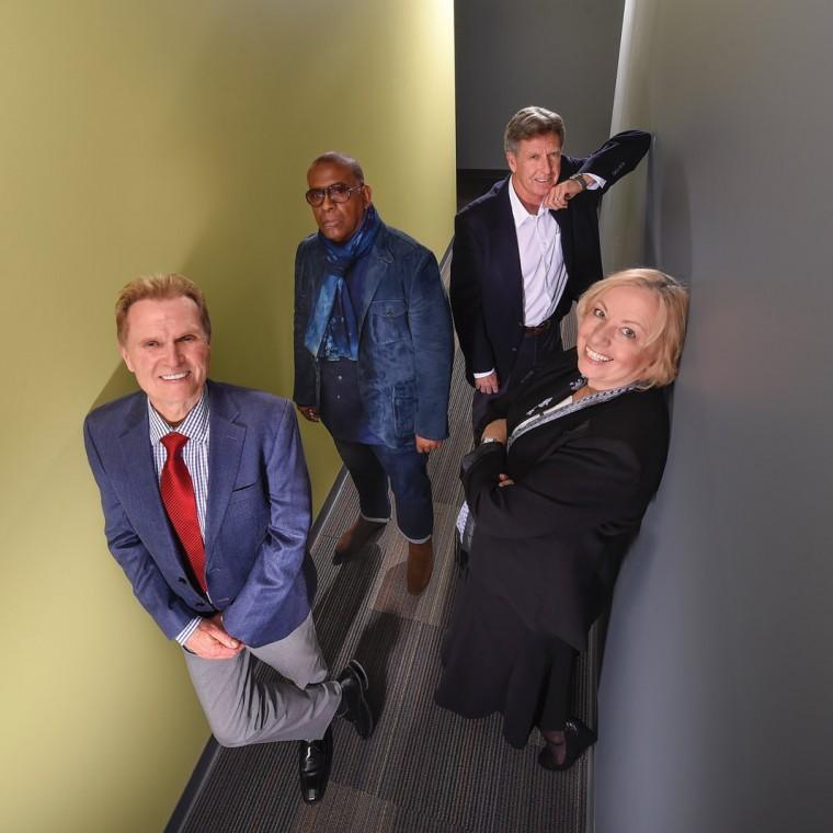 USC professors in a narrow hallway